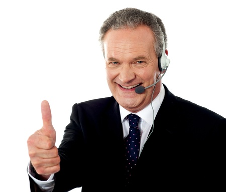 thumbsup: Call centre executive smiling with thumbs-up gesture isolated over whte background