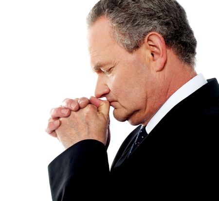 Business person praying god to God. Eyes closed photo