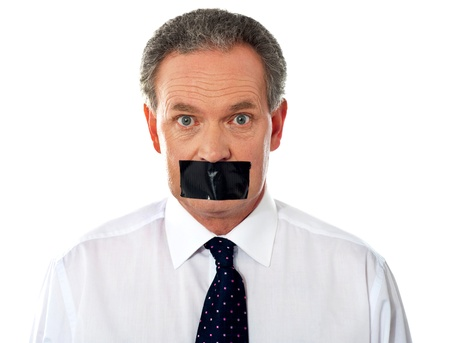 covering mouth: Portrait of matured businessman with duct tape on his mouth Stock Photo