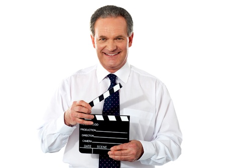 Aged corporate male holding clapperboard. Shot on white background photo