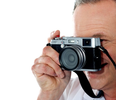 Cropped image of aged male photographer. Closeup shot photo