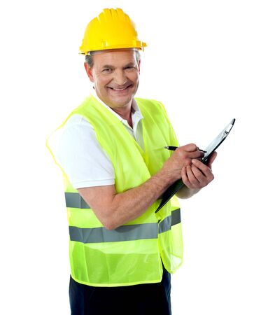 Happy senior construction engineer with safety hat and jacket photo