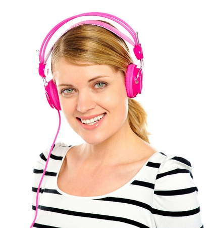 Attractive cheerful caucasian woman listening and enjoying music in headphones Stock Photo - 13823319