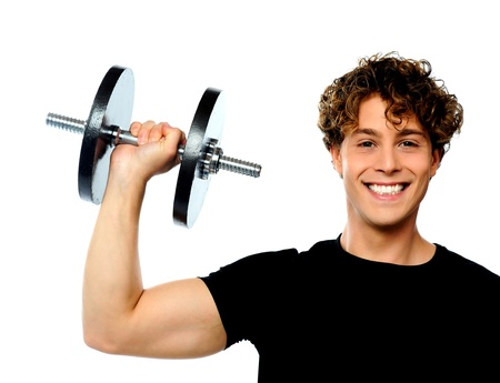 Powerful muscular young man lifting weight, smiling pose photo