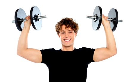 Smiling athlete wearing sporty outfit, lifting weights photo