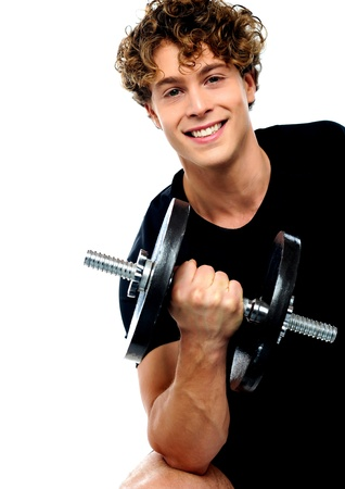Smiling athlete doing exercise with dumbbell photo