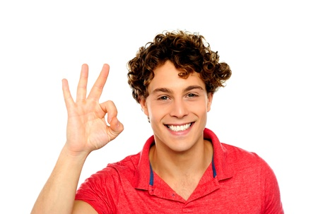 yup: Curly hair guy gesturing excellence sign. Isolated on white Stock Photo