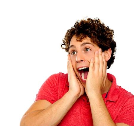 A young man with a surprised look on his face. Hands on his cheek. Stock Photo - 13823917