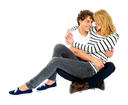 deeply: Couple looking at each other. Girl sitting on lap of her partner. Deeply in love