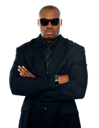 Serious african man in business suit. Posing with crossed arms