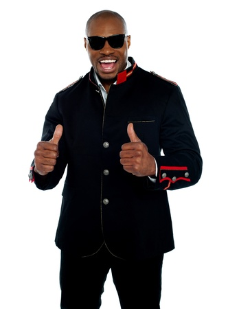 posing  agree: Handsome excited african with double thumbs-up over white background