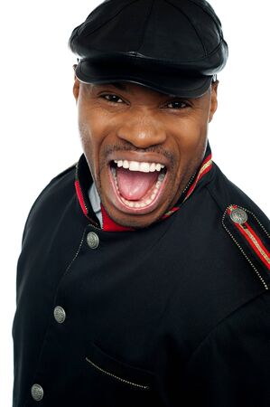 Shouting african man wearing cap isolated over white. Closeup shot photo