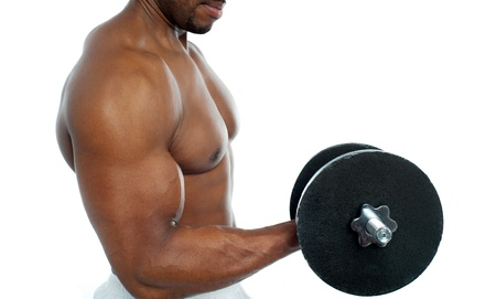 Cropped image of a bodybuilder exercising over white background photo