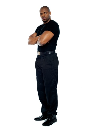 Male security guard with strong arms crossed on white background