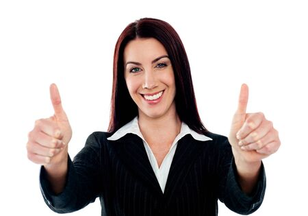 Confident businesswoman showing double thumbs-up isolated over white photo