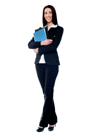 Isolated business woman holding documents. Full length portrait photo