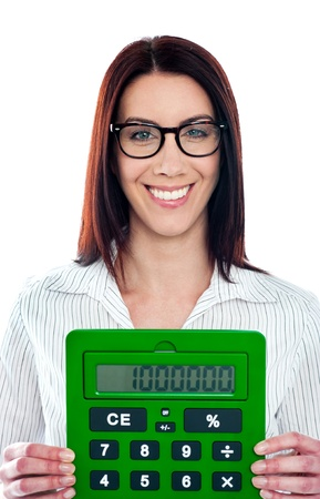 Smiling corporate lady showing green calculator to camera photo