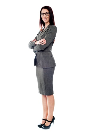 Beautiful sucessful businesswoman with folded arms isolated on white background Stock Photo - 14043433