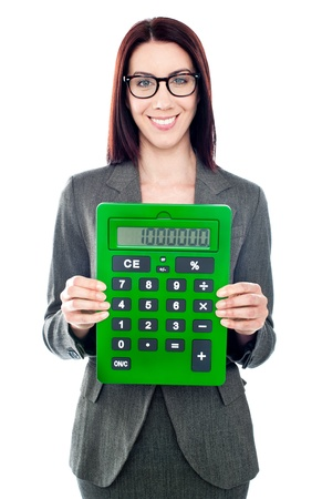 Business woman with a calculator. Showing it to camera photo