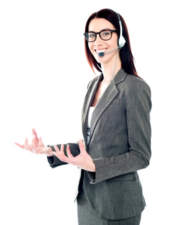 Smiling telemarketing girl posing in headsets against white background photo
