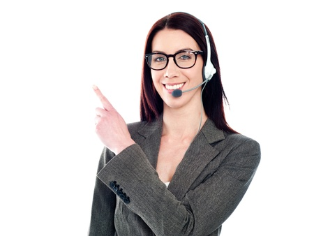 Customer support phone operator with headset pointing at something