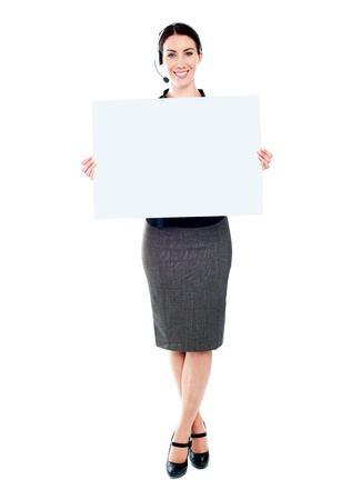 customercare: Telemarketing femlae holding a blank billboard. Full length portrait Stock Photo