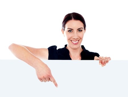 customercare: Call-centre representative pointing towards placard. Copy space concept