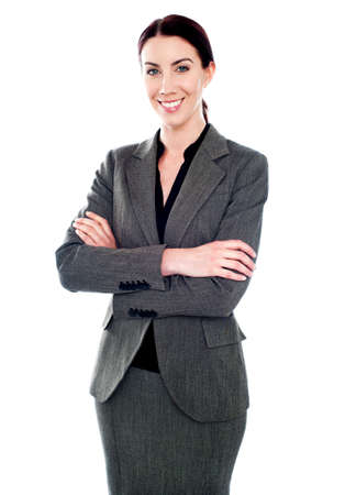Corporate lady standing with her arms crossed isolated against white background Stock Photo - 14043468