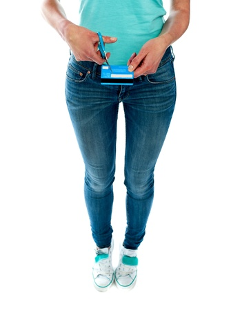 Woman cutting credit card with scissors. Cropped image photo