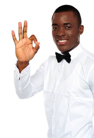 yup: Young african boy showing okay gesture to camera