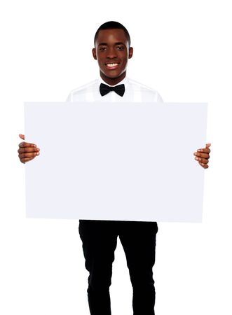 African business representative holding blank billboard over white background photo