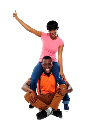 Couple having fun. Studio shot. All on white background photo