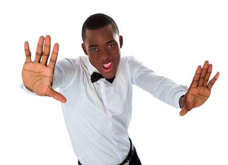 Happy stylish black man stretching to camera against white background photo