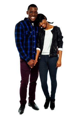 young teen girl nude: African young couple holding hands. Woman with her head on mans shoulder Stock Photo