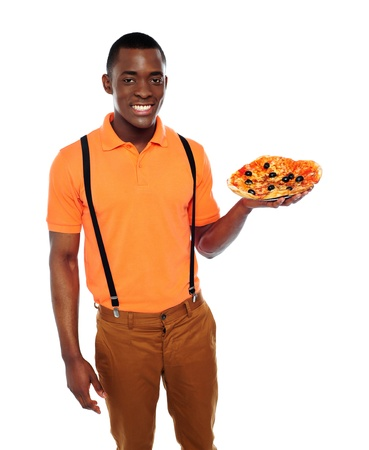 Handsome black man holding pizza isolated over white photo