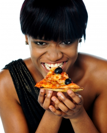 Woman enjoying pie of a pizza isolated on white. Closeup Stock Photo - 14050610