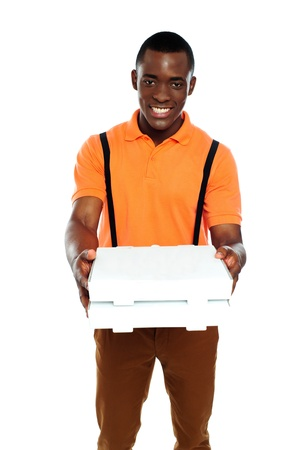 Pizza boy delivering an order isolated against white background photo