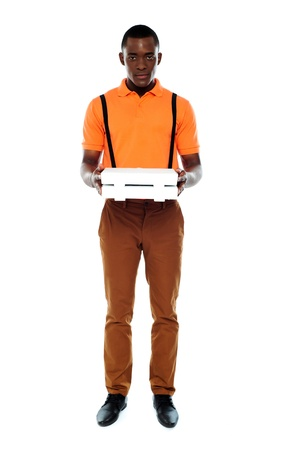 Full length portrait of delivery boy with pizza isolated over white photo