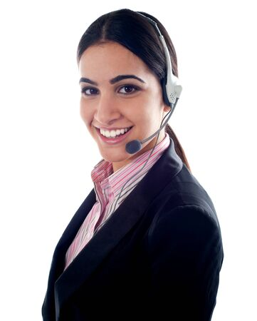 Smiling female telemarketer with headsets. All on white background photo