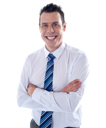 Smiling young handsome executive posing with folded arms Stock Photo - 14087851