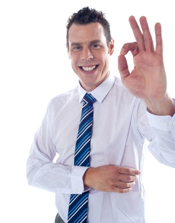 yup: Young corporate associate gesturing excellent sign to camera