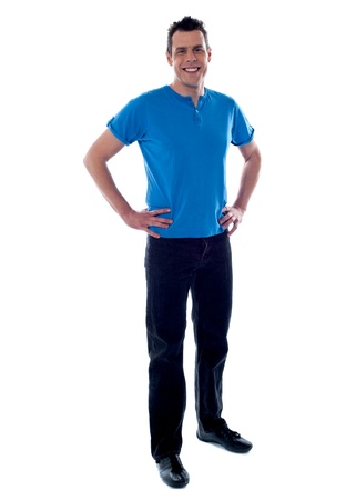 casuals: Handsome guy posing with hands on his waist wearing casuals Stock Photo