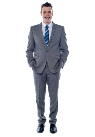 Confident executive posing with hands in pocket. Smiling at camera Stock Photo - 14087729