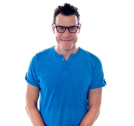 eye wear: Hombre joven y guapo sonriendo a la c�mara usando gafas Foto de archivo