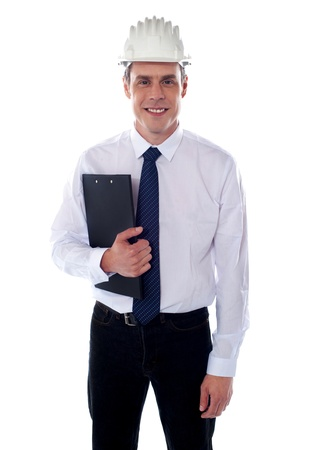 Handsome young architect holding clipboard and looking at you photo