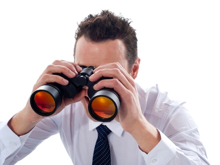 Businessman looking through binoculars isolated on white background Stock Photo - 14087833