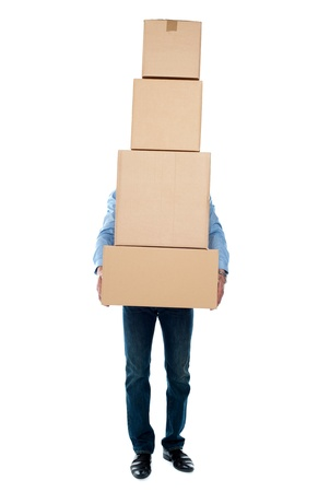 relocating: Guy carrying heavy packages isolated over white background. Overloaded