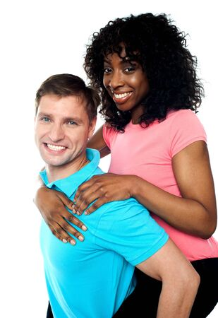 African woman enjoying piggy ride while her American boyfriend carries her Stock Photo - 14087979