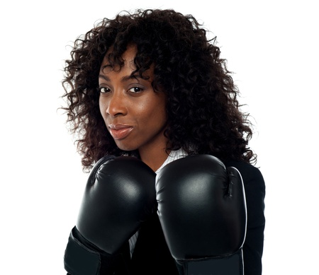 Beautiful female executive wearing boxing gloves. Get ready for some action