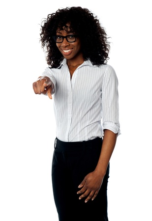 African female manager pointing at you  isolated over white photo